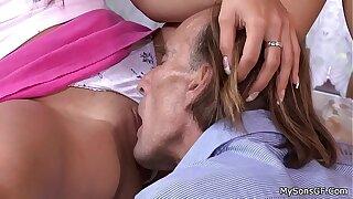 Pigtailed brunette spreads legs for oldman
