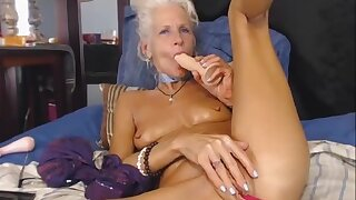 Grey haired Granny dildoing on Cam