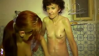 Old Granny playing with young sexy girl in bathroom