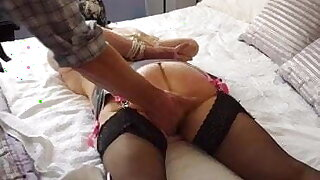 Tied hooded granny gets paddled and spanked