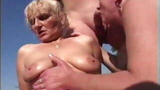 Granny Marianne has outdoor orgy