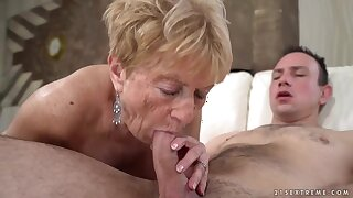 Mature blonde woman in a pink shirt, Malya likes to fuck Rob, on a daily basis