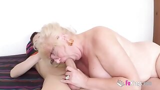 Blonde woman with big tits is having casual sex with a much younger guy and loving it