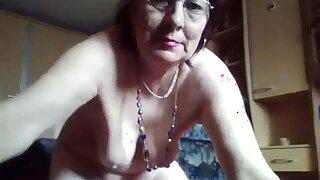 Hairy granny enjoys peeing in the bucket