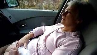 Beautiful granny masturbates herself in the car