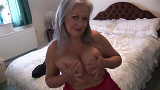 Busty gorgeous granny in slip and stocking spreads