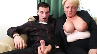 Old slutty granny rides two young cocks